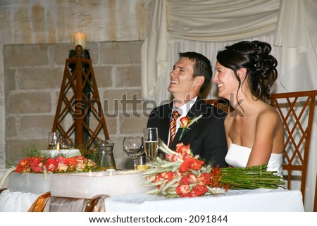 Bride and groom sitting at table at ceremony