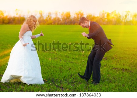 bride and groom sunlight dancing merrily in green field, couple, wedding fall