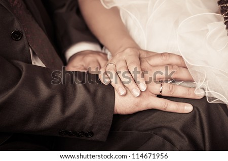 bride and groom to hold hands. loving care. retro photo