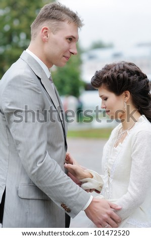 Bride and groom together outdoors
