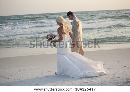 Bride and Groom Walking Along the Beach