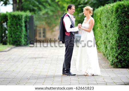 bride and groom walking along the street