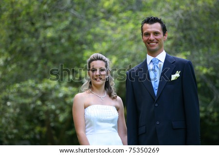 stock photo bride and groom wedding day in the park