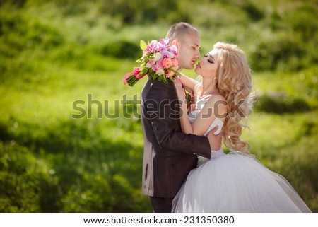 Bride and groom wedding loving couple. Kissing man and woman. Happy newlywed family dancing in green park. Bridal wedding couple Marriage. happy family, series. soft selective focus and sunset