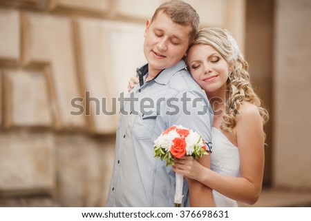 Bride and groom wedding portrait outdoors newlyweds loving couple kissing marriage bridal flowers, kissing man and woman at wedding day, selective focus, series #376698631