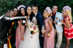 Bride and groom with bridesmaids at  wedding walk outdoors