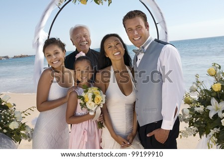 Bride and Groom With Family on Beach