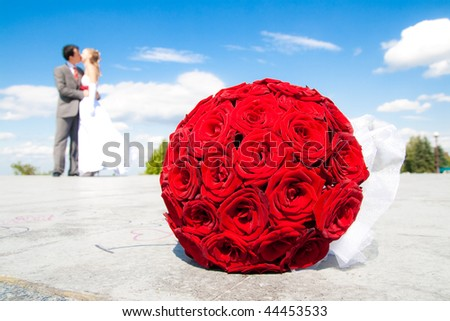bride and groom with wedding bouquet