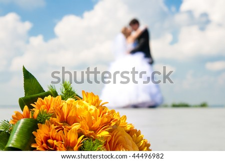 bride and groom with wedding flowers