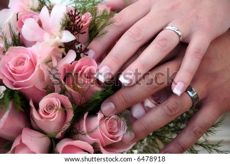 bride and grooms hands showing off their rings
