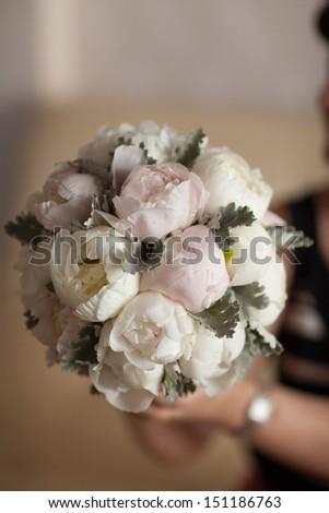 Bride bouquet of wedding flowers white peony. Wedding day decoration. Classic Wedding bouquet of peony. Beautiful wedding flowers. Bridal flowers. Bouquet of bride. Autumn wedding flowers.  Marriage