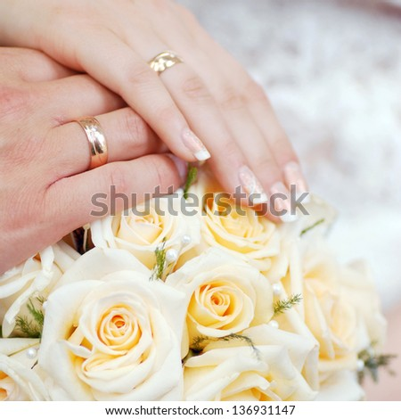 bride bouquet of yellow flowers and cushion with wedding  gold rings