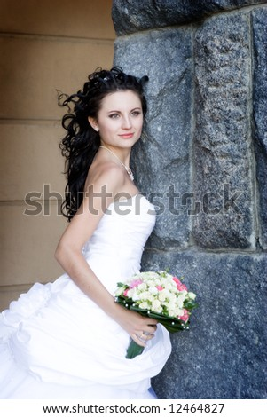 bride by the stone wall