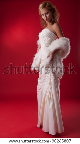 Bride fashion model in wedding dress on podium standing
