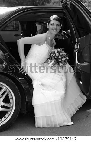 Bride getting out of wedding limo