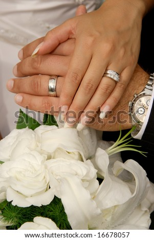 stock photo Bride Groom wearing wedding rings