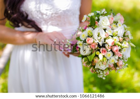 bride holding a bouquet of white pink roses, close up #1066121486