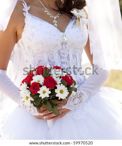stock photo Bride holding beautiful red roses wedding flowers bouquet