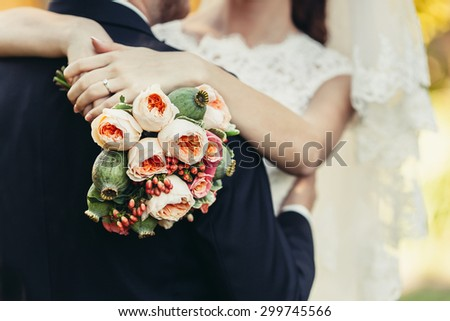 Bride holding big wedding bouquet on wedding ceremony