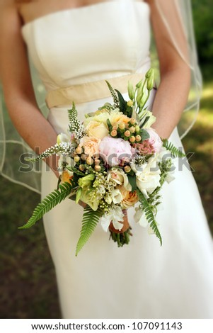 Bride Holding Bouquet of Flowers on Her Wedding Day