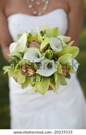 Bride holding bouquet of green and white flowers