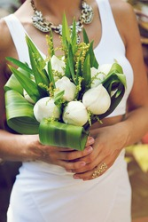Bride holding exotic lotus wedding bouquet ,creative marriage in hot topical country.