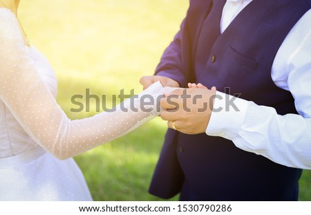bride holding girl broom hand for checking dress  in wedding day