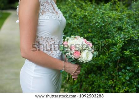 Bride holding her wedding bouquet. #1092503288