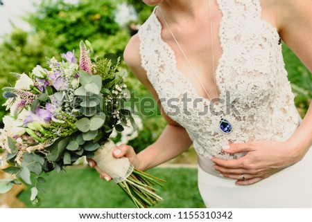 Bride holding her wedding bouquet with white dress. #1155310342