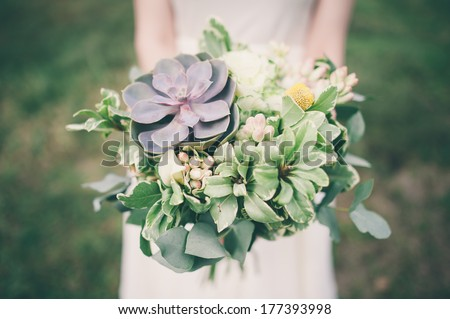 Bride Holding The Wedding Bouquet, With Succulent Flowers, Close-Up
