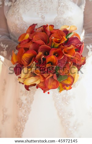 holding wedding bouquet of