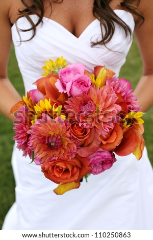 Bride Holding Wedding Bouquet with Orange and Pink Flowers