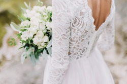 Bride holds a wedding bouquet, wedding dress, wedding details