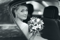bride in a wedding car