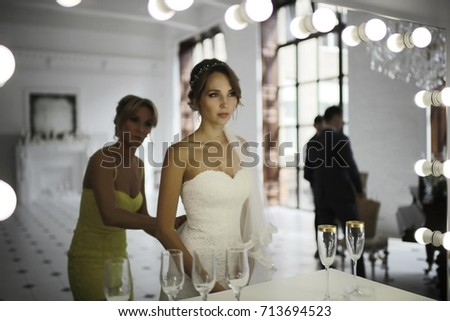Bride in a white dress at a wedding is beautifully solemn