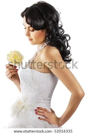 Bride in elegant wedding dress on white