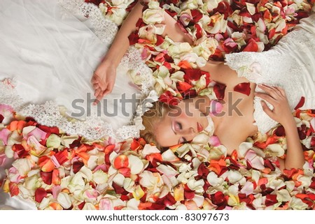 Bride in the petals of roses
