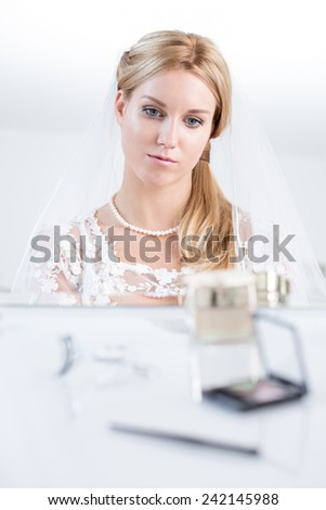 Bride in wedding dress worrying before big day