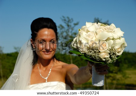Bride in white dress with flower bouquet