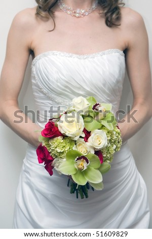 bride is holding wedding flower bouquet