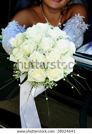 stock-photo-bride-is-sitting-in-the-car-and-holding-wedding-white-flowers-38024641.jpg