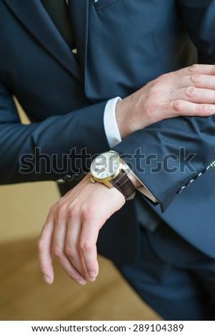 bride looking at hand watch