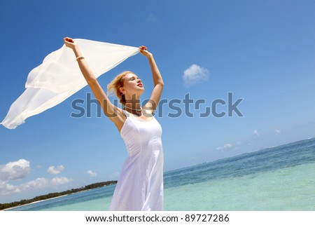 Bride on the beach with white stole