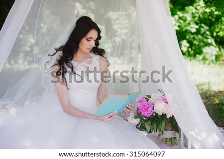 Bride on the nature of reading a book, decor, peonies, flowers, lifestyle, marriage, family, love