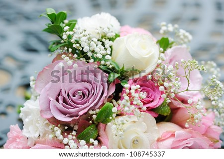 Bride pink and white rose bouquet before wedding