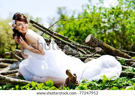 Bride posing showing  wedding dress