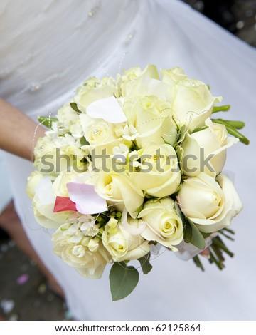 Bride's bouquet of cream roses with confetti