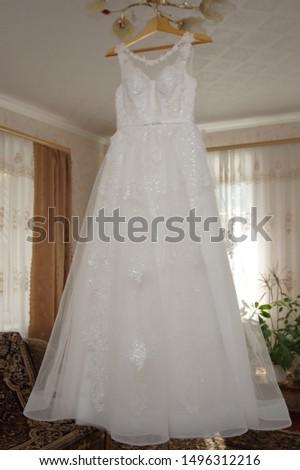 Bride's dress. White dress. Grooming dress White dress in the center of the room. #1496312216