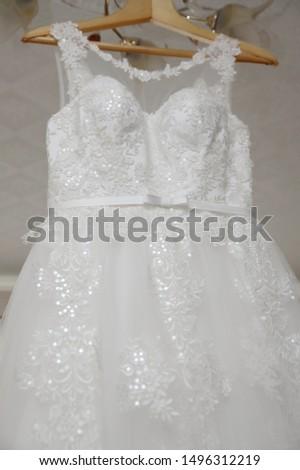 Bride's dress. White dress. Grooming dress White dress in the center of the room. #1496312219