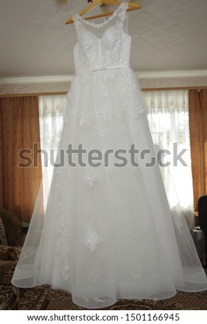 Bride's dress. White dress. Grooming dress White dress in the center of the room. #1501166945